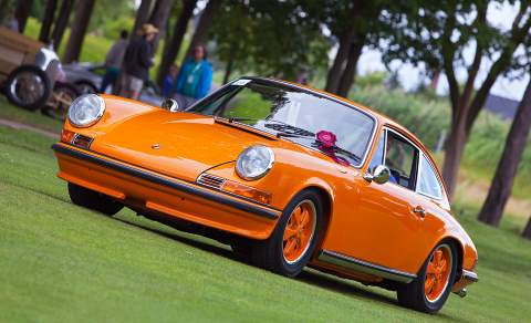 A Porsche 911 in luminous Signal Orange