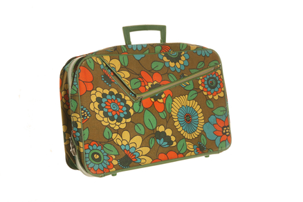 Unmistakable on the luggage carousel: a suitcase with flower power.