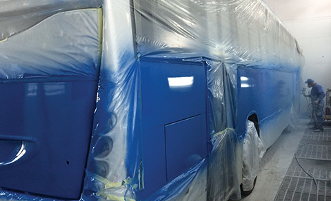 Painting of bus in spray booth